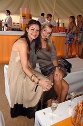 Left to right, SOPHIE COCKERTON and Singer LOUISE REDNAPP at the final of the Veuve Clicquot Gold Cup 2007 at Cowdray Park, West Sussex on 22nd July 2007.<br />