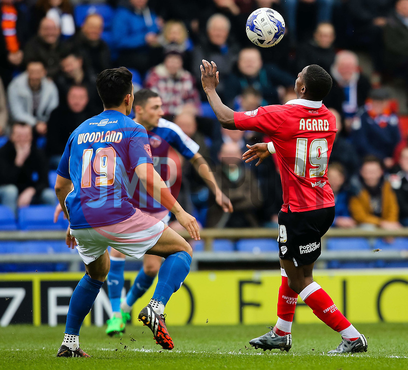 Oldham Athletic's Luke Woodland and Bristol City's Kieran Agard in action - Photo mandatory by-line: Matt McNulty/JMP - Mobile: 07966 386802 - 03/04/2015 - SPORT - Football - Oldham - Boundary Park - Oldham Athletic v Bristol City - Sky Bet League One