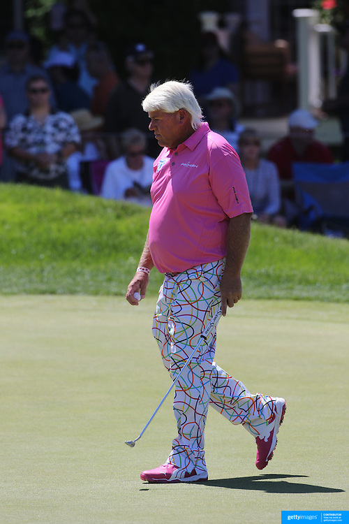 John Daly, USA, in action during the third round of the Travelers Championship at the TPC River Highlands, Cromwell, Connecticut, USA. 21st June 2014. Photo Tim Clayton