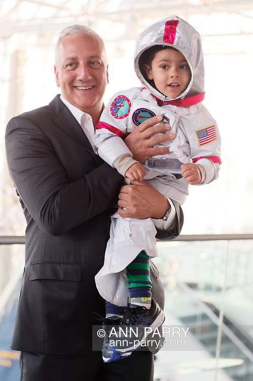 Garden City, New York, USA. June 21, 2018. NASA space shuttle astronaut MIKE MASSIMINO poses holding GIOVANNI, a 3 1/2 year old boy wearing a space suit costume, from Manhasset, before the former astronaut gave a free lecture at the Cradle of Aviation Museum.