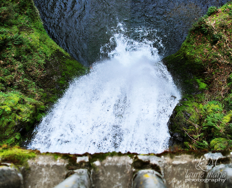 Looking down at Lower Multnomah Falls from the iconic bridge spanning it.