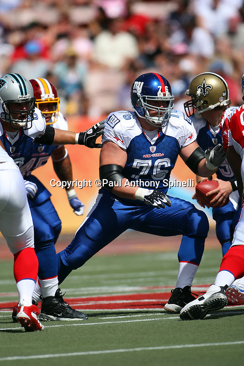 HONOLULU, HI - FEBRUARY 08: NFC All-Stars guard Chris Snee #76 of the New York Giants blocks against the AFC All-Stars in the 2009 NFL Pro Bowl at Aloha Stadium on February 8, 2009 in Honolulu, Hawaii. The NFC defeated the AFC 30-21. ©Paul Anthony Spinelli *** Local Caption *** Chris Snee