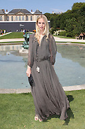 PARIS, FRANCE - JULY 04:  Poppy Delevigne attends the Christian Dior Haute Couture Fall/Winter 2011/2012 show as part of Paris Fashion Week at Musee Rodin on July 4, 2011 in Paris, France.  (Photo by Tony Barson/WireImage)