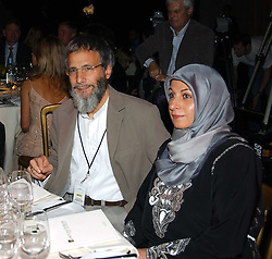 YUSUF ISLAM former known as Cat Stevens with one of his daughters on his right and his wife on his left at the Fortune Forum Dinner held at Old Billingsgate, 1 Old Billingsgate Walk, 16 Lower Thames Street, London EC3R 6DX<br />