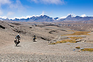 Motorcycle touring in the Bolivian Andes.  Adventure riders head across passes around 15,000 ft above sea level while touring the spine of the Bolivian Andes near La Paz, Bolivia.