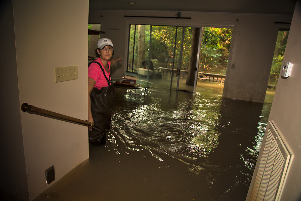 Hilary Purcell in the home she rents in he Gessner and Bayou Shadows area, in Houston, Texas. The flooding in this part of town was impacted by the water released from the  Addicks Dam as well as Harvey's delluge of rain.  When the Addicks Resivoir started to over flow the U.S. Army Corps of Engineers began releasing water from the Addicks Dam, which had already started to overflow.