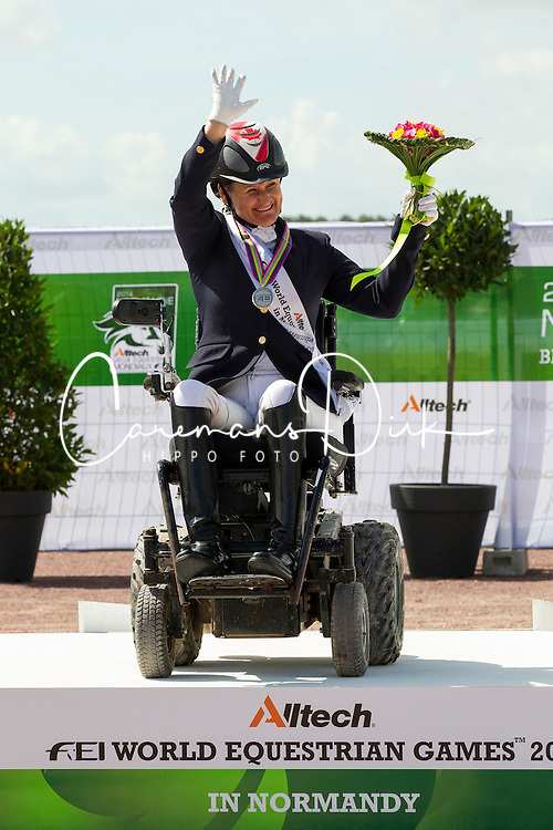 Caroline Cecilie Nielsen and Leon win silver in the Freestyle Grade II Para Dressage - Alltech FEI World Equestrian Games™ 2014 - Normandy, France.<br /> © Hippo Foto Team - Leanjo de Koster<br /> 25/06/14