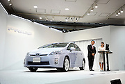 Akio Toyoda, Executive Vice President of Toyota Motor Corp., speaks in front of the third generation Prius hybrid car, which was unveiled at the automaker's showroom in Tokyo, Japan on 18 May 2009.