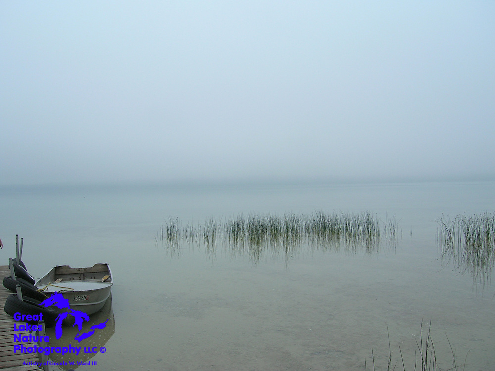 On a calm August morning, the lake is shrouded in a quiet, peaceful mist.<br /> <br /> North Manistique Lake, in Michigan's Upper Peninsula.