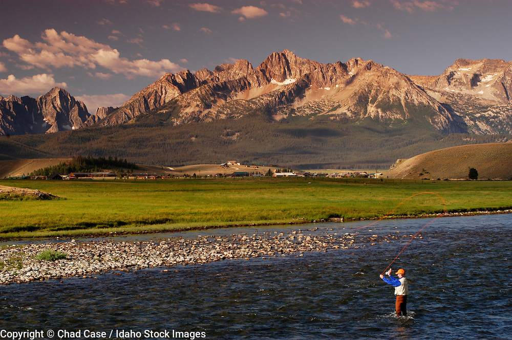 Idaho. Fishing on Salmon River in Stanley with Sawtooth Mountains. MR