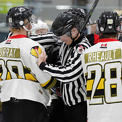 TRENTON, ON  - MAY 5,  2017: Canadian Junior Hockey League, Central Canadian Jr. &quot;A&quot; Championship. The Dudley Hewitt Cup. Game 7 between The Georgetown Raiders and The Powassan Voodoos. OHA Linesman breaks up an altercation during the third period. <br />  (Photo by Amy Deroche / OJHL Images)