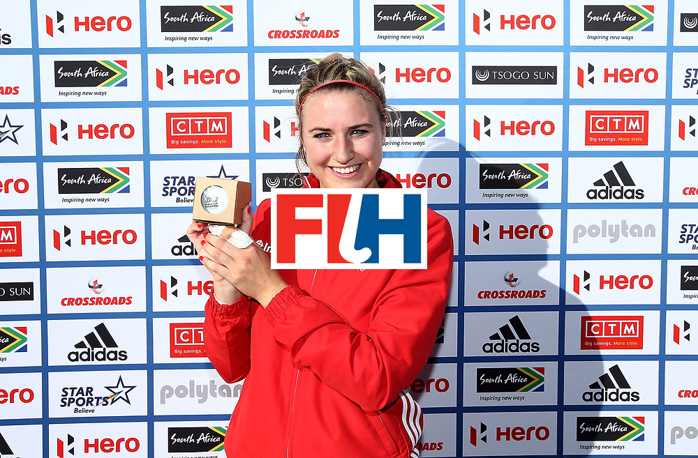 JOHANNESBURG, SOUTH AFRICA - JULY 16:  Lily Owsley of England poses with her milestone award commemorating 100 caps during day 5 of the FIH Hockey World League Women's Semi Finals Pool A match between England and Ireland at Wits University on July 16, 2017 in Johannesburg, South Africa.  (Photo by Jan Kruger/Getty Images for FIH)