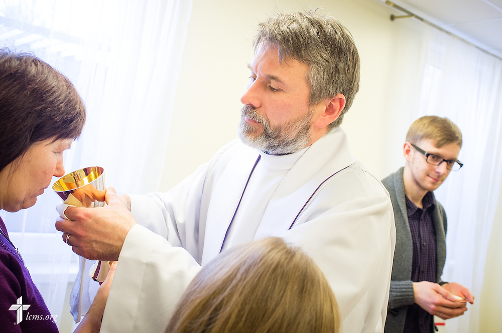 The Rev. Ivo Kirsis, a parish pastor in The Evangelical Lutheran Church of Latvia, leads Divine Service on Wednesday, Feb. 4, 2015, at a Diaconia Center mercy project site based in a municipal apartment in Riga, Latvia. LCMS Communications/Erik M. Lunsford