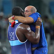 Wrestling - Olympics: Day 10   Mijain Lopez Nunez of Cuba celebrates with his coach Raul Trujillo of Cuba, after winning his third straight Olympic Gold Medal winning in  the Men's Greco-Roman 130 kg at the Carioca Arena 2 on August 15, 2016 in Rio de Janeiro, Brazil. (Photo by Tim Clayton/Corbis via Getty Images)