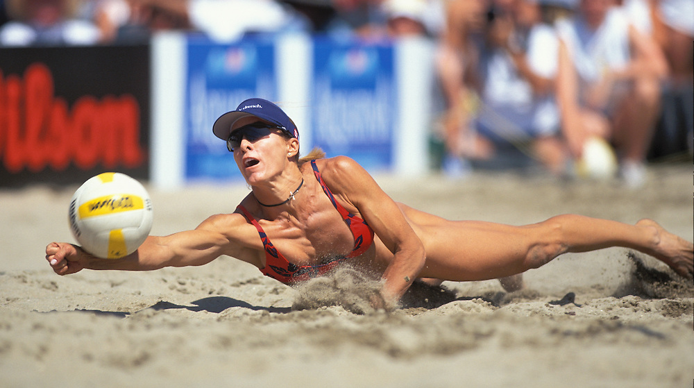 AVP Professional Volleyball - Huntington Beach, CA - 2002 - Holly McPeak dives to return a ball in an AVP beach volleyball tournament held in Huntington Beach, CA. Photo by Wally Nell/DIG Magazine
