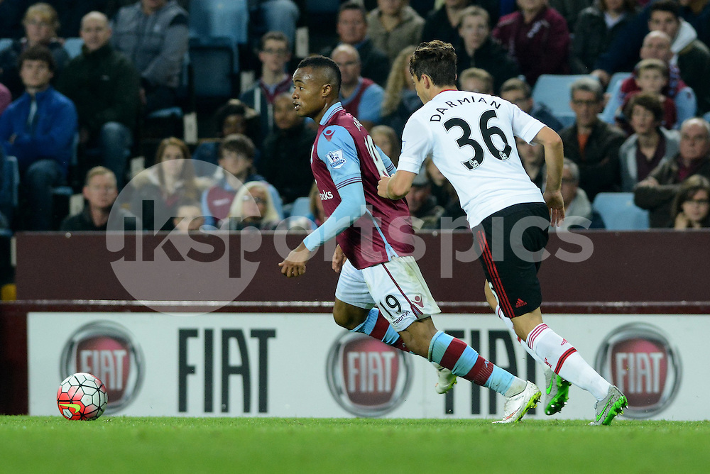 Aston Villa's Jordan Ayew watched by Manchester United's Matteo Darmian during the Barclays Premier League match between Aston Villa and Manchester United at Villa Park, Birmingham, England on 14 August 2015. Photo by Garry Griffiths.