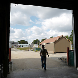 Kris Zimmerman, a Mennonite and owner of 5-Star Buildings walks into the workshop in Cuba, Missouri on Thursday, Sept. 29, 2016. (Photo by Keith Birmingham Photography)