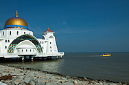 Melaka Straits Mosque or Masjid Selat Melaka, combines Middle Eastern and  Malay architecture and crafttsmanship.  The mosque faces the Malacca Strait and is built on stilts over the water so that it looks like a floating structure if the water level is high. This mosque showcases modern Islamic architecture. Apart from serving as a place of worship, it has also become a Malacca tourist destination.
