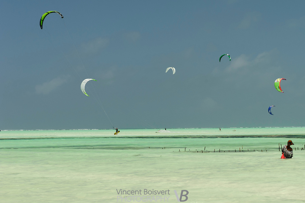 Kitesurfer at low tide on paje beach, zanzibar, tanzania