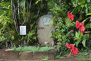Tomb of the Belgian singer Jacques Brel, 1929-78, in Calvary Cemetery, near Atuona, on the island of Hiva Oa, in the Marquesas Islands, French Polynesia. The tomb features a relief portrait of Brel with his partner, Maddly Bamy, a Guadeloupe born French actress and singer. Picture by Manuel Cohen