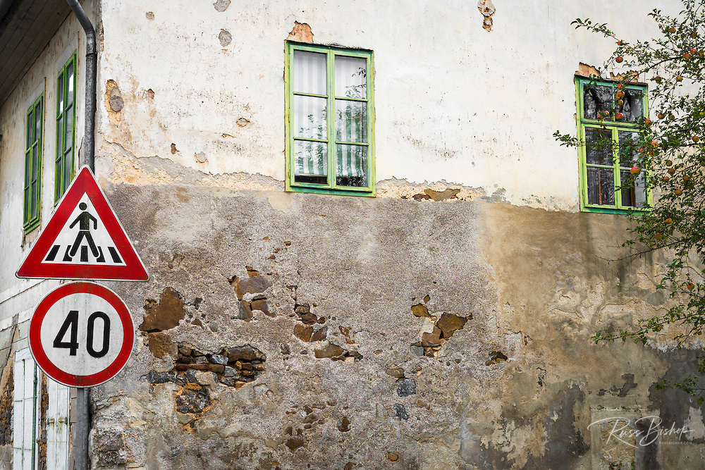 Weathered wall and road sign, Brod, Croatia