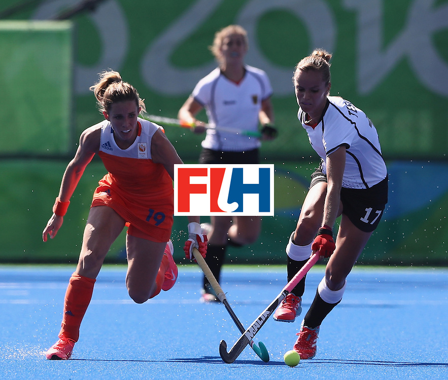 RIO DE JANEIRO, BRAZIL - AUGUST 13:  Jana Teschke of Germany is tackled by Eilen Hoog during the Women's group A hockey match between the Netherlands and Germany on Day 8 of the Rio 2016 Olympic Games at the Olympic Hockey Centre on August 13, 2016 in Rio de Janeiro, Brazil.  (Photo by David Rogers/Getty Images)