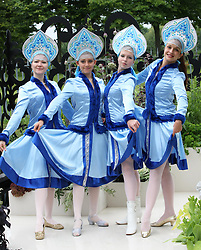 Russian dancers at the Russian Museum Garden at the preview day of the RHS Hampton Court Palace flower show , Monday, 2nd July 2012.  Photo by: Stephen Lock / i-Images