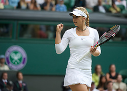 LONDON, ENGLAND - Saturday, July 2, 2011: Sabine Lisicki (GER) in action during the Ladies' Doubles Final match on day twelve of the Wimbledon Lawn Tennis Championships at the All England Lawn Tennis and Croquet Club. (Pic by David Rawcliffe/Propaganda)