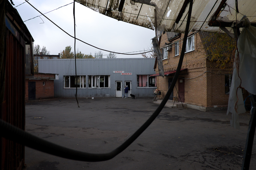 DONETSK, UKRAINE - OCTOBER 22, 2014: A market area in Kievskiy shows signs of destruction after being hit by occasional shelling. Due to the proximity to Donetsk airport, the district has in the past months been one of the most affected by the heavy fighting between DNR separatist combatants and the Ukrainian National Guard. Most of the area's residents fled their home but many still remain chancing deadly stick on a daily basis. CREDIT: Paulo Nunes dos Santos