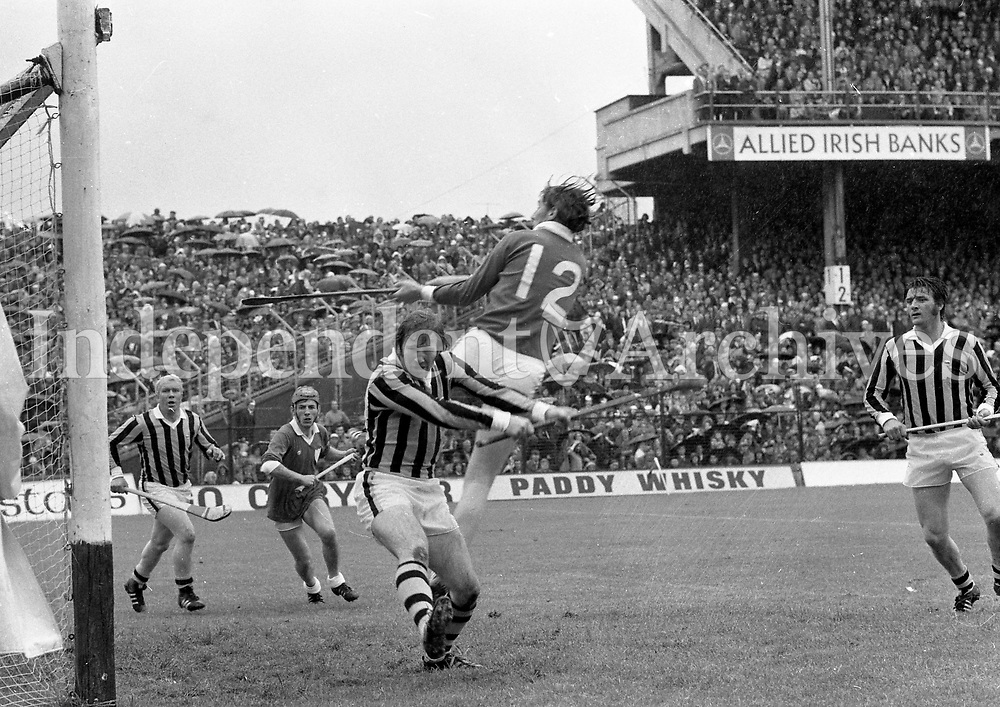 974-11d<br /> 'Brave Save' - Kilkenny's Noel Skehan clears his goal as Limerick's Matt Ruth 'hitches-a-ride' at the All-Ireland Hurling Final at Croke Park. <br /> (Part of the Independent Newspapers Ireland/NLI collection.)