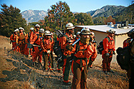 MALIBU, CA - NOV 11: Fire crews prepare to clear brush around a fire the Salvation Army Camp on November 10, 2018 in Malibu, California. (Photo by Sandy Huffaker/Getty Images)