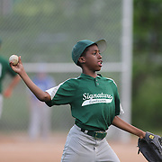 An outfielder warms up during the Norwalk Little League baseball competition at Broad River Fields,  Norwalk, Connecticut. USA. Photo Tim Clayton