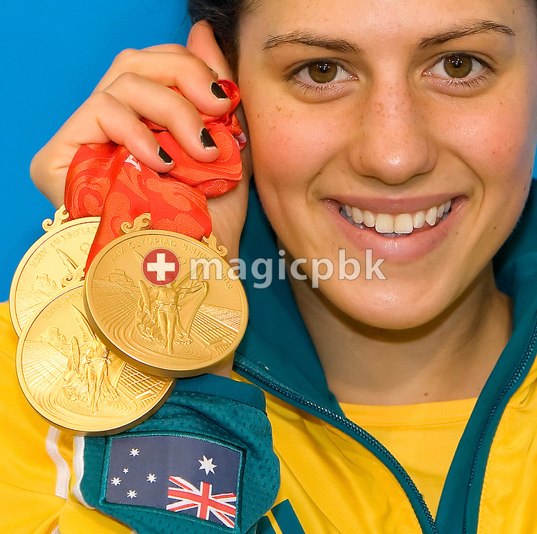 Triple Olympic champion Stephanie RICE of Australia poses with her three Gold medals (200m IM, 400m IM and 4x200m Freestyle Relay) after a press conference at the National Aquatics Center (Water Cube) at the Beijing 2008 Olympic Games in Beijing, China, Sunday, Sept. 14, 2008. (Photo by Patrick B. Kraemer / MAGICPBK)