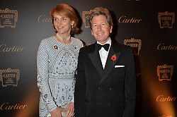 JOHN WARREN and LADY CAROLYN WARREN at the 26th Cartier Racing Awards held at The Dorchester, Park Lane, London on 8th November 2016.