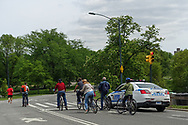 Bikers stopping for a red light under the watchful eye of the New York Police Department