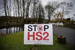© Licensed to London News Pictures. 27/01/2012. Little Missenden, UK. An anti HS2 (High Speed Rail 2) sign in the village of Little Missenden, Buckinghamshire. Scheduled to be completed by 2033, the new Rail system will have huge effects on the chocolate box English village. Photo credit : Ben Cawthra/LNP
