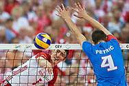 Poland, Warsaw - 2017 August 24: (L) Lukasz Kaczmarek from Poland spikes against (R) Nemanja Petric from Serbia during LOTTO EUROVOLLEY POLAND 2017 - European Championships in volleyball at Stadion PGE Narodowy on August 24, 2017 in Warsaw, Poland.<br /> <br /> Mandatory credit:<br /> Photo by © Adam Nurkiewicz<br /> <br /> Adam Nurkiewicz declares that he has no rights to the image of people at the photographs of his authorship.<br /> <br /> Picture also available in RAW (NEF) or TIFF format on special request.<br /> <br /> Any editorial, commercial or promotional use requires written permission from the author of image.