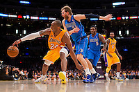 02 April 2013: Guard (24) Kobe Bryant of the Los Angeles Lakers has the ball knocked out his hand by (41) Dirk Nowitzki of the Dallas Mavericks during the second half of the Lakers 101-81 victory over the Mavericks at the STAPLES Center in Los Angeles, CA.