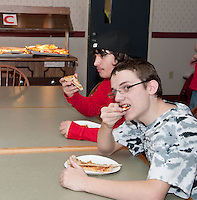 Trying to pick the Best Pizza in Town is not an easy task but an enjoyable one for Michael Cavette and Caelan Norwood during NH Jag's 4th annual Best Pizza in Town contest Thursday evening at Laconia High School.  (Karen Bobotas/for the Laconia Daily Sun)