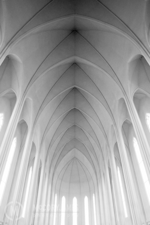 Black and white photograph of the interior of Hallgrimskirkja, a Lutheran church in Reykjavik, Iceland. Designed by architect Guðjón Samúelsson.