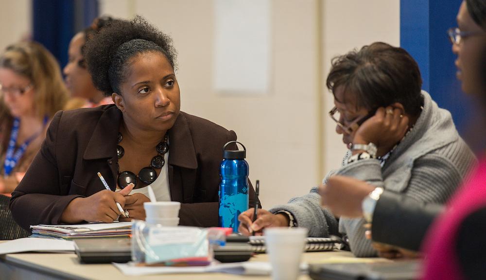 Houston ISD teacher development specialists discuss ways to improve communication during a workshop at Ryan School, December 8, 2014.