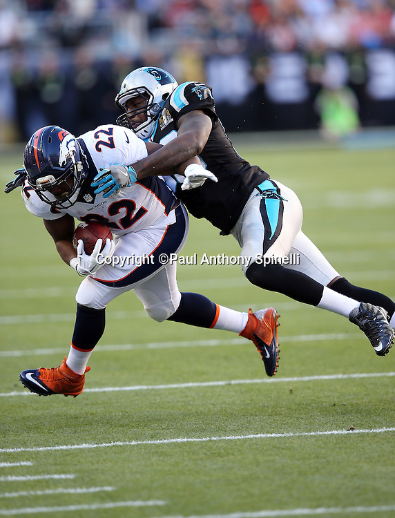 Denver Broncos running back C.J. Anderson (22) gets tackled by Carolina Panthers outside linebacker Thomas Davis (58) during the NFL Super Bowl 50 football game against the Carolina Panthers on Sunday, Feb. 7, 2016 in Santa Clara, Calif. The Broncos won the game 24-10. (©Paul Anthony Spinelli)