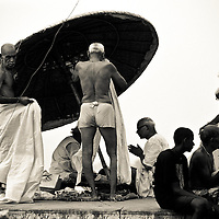 Old men undress to swim in the Ganges.<br /> Varanasi also known as Benares, is a city on the banks of the Ganges (Ganga) in Uttar Pradesh, 320 kilometres (200 mi) southeast of the state capital, Lucknow. It is the holiest of the seven sacred cities in Hinduism and Jainism, and played an important role in the development of Buddhism. Some Hindus believe that death at Varanasi brings salvation.It is one of the oldest continuously inhabited cities in the world and the oldest in India.<br /> The ganges river rising in the Himalayas and emptying into the Bay of Bengal, it drains a quarter of the territory of India, while its basin supports hundreds of millions of people.