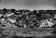 Traditional tatami mats from homes overwhelmed and destroyed by the 11 March tsunami piled up at a permanent dump on a man-made peninsula of landfill in Ishinomaki's port.  Miyagi Prefecture, Japan.  The creation of so much organic refuse from the tsunami debris has resulted in more spontaneous combustion from methane emitted from the decomposint debris, releasing noxious fumes.