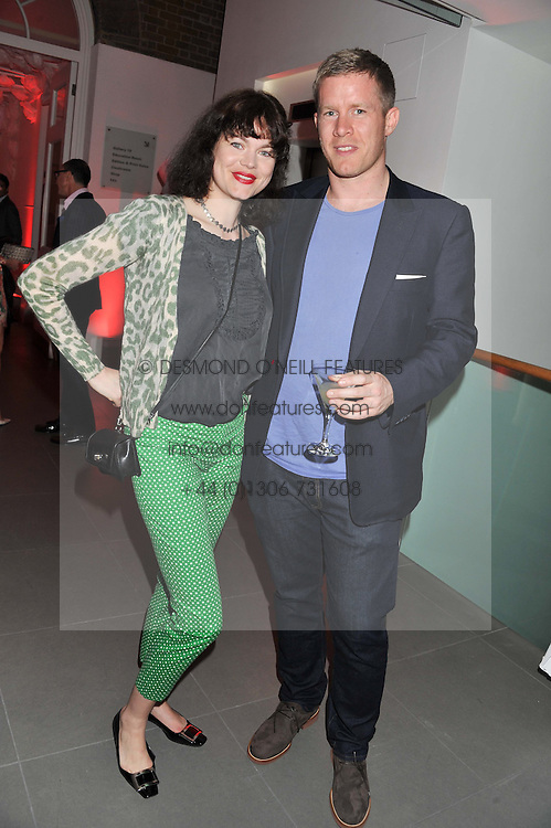 JASMINE GUINNESS and BEN BRIDGEWATER at a party hosted by Ines de la Frassange and Bruno Frisoni for Roger Vivier to launch the Roger Vivier book held at The Saatchi Gallery, London on 24th April 2013.