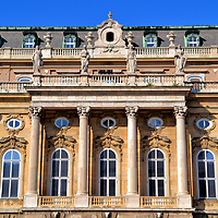 Hungarian National Gallery at Buda Castle in Budapest, Hungary <br /> During the reign of Maria Theresa – Queen of Hungary and Croatia from 1740 until 1780 – a U-shaped palace was added to the castle with a central courtyard (cour d'honneur). The façade was designed by Franz Hillebrandt in 1765. This is one of four buildings at Buda Castle constituting the Hungarian National Gallery. Magyar Nemzeti Galéria was founded in 1957, yet the museum's collection of over 100,000 pieces began in 1839. The permanent exhibits include Hungarian art and artifacts, some dating back over 500 years.