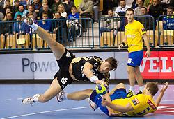 Marcus Ahlm of Kiel  vs Ziga Mlakar of Celje during handball match between RK Celje Pivovarna Lasko (SLO) and THW Kiel (GER) in 5th Round of Group B of EHF Champions League 2012/13 on November 17, 2012 in Arena Petrol, Celje, Slovenia. Triglav defeated Celje 2-1. (Photo By Vid Ponikvar / Sportida)