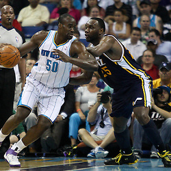 April 11, 2011; New Orleans, LA, USA; New Orleans Hornets center Emeka Okafor (50) is guarded by Utah Jazz center Al Jefferson (25) during the first half at the New Orleans Arena.  Mandatory Credit: Derick E. Hingle