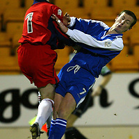 St Johnstone v Airdrie..  04.02.03<br />Mark McGeown beats Chris Hay to the ball<br /><br />Pic by Graeme Hart<br />Copyright Perthshire Picture Agency<br />Tel: 01738 623350 / 07990 594431