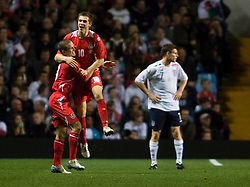 BIRMINGHAM, ENGLAND - Tuesday, October 14, 2008: Wales' Aaron Ramsey celebrates scoring the first goal against England with team-mate Rhoys Wiggins during the UEFA European Under-21 Championship Play-Off 2nd Leg match at Villa Park. (Photo by Chris Ratcliffe/Propaganda)